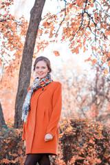 Beautiful girl in an orange coat