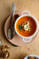 pumpkin soup in a white tureen