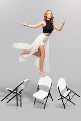 Fashionable woman balancing