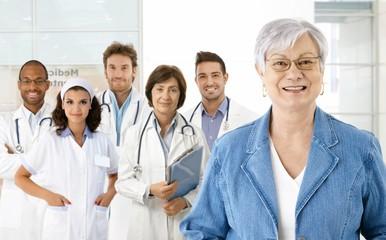 Pensioner and medical team
