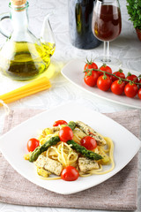 Pasta with swordfish, asparagus and cherry tomatoes