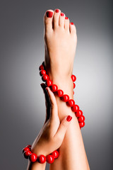 Wall Murals Pedicure Closeup photo of a beautiful female feet with red pedicure