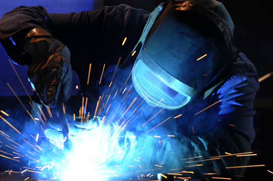 worker while doing a welding with arc welder