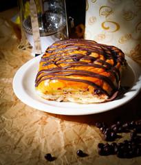 chocolate bun with chocolate sauce