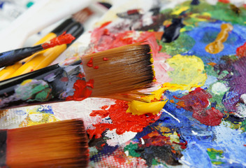 Art palette and mix of paintbrushes