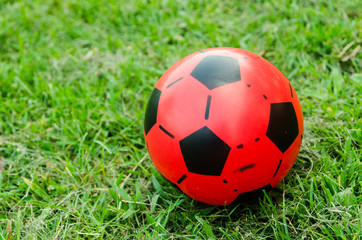 Red Soccer ball in the field