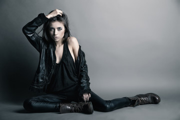 Fashion model wearing leather pants and jacket