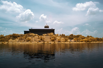 Building by the lakeside in Putrajaya, Malaysia in infrared