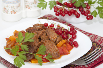 Meat stew with vegetables and red currants