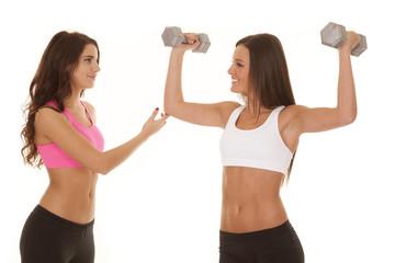 Two women fitness train flex