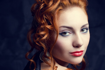 Vintage portrait of a glamorous queen like red-haired woman