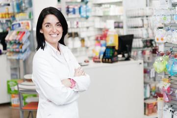 cheerful smiling pharmacist chemist woman standing in pharmacy d