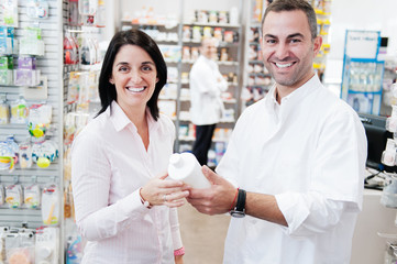 Pharmacist and customer smiling in a pharmacy