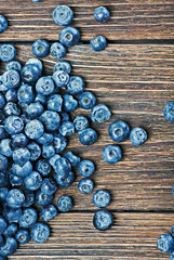 blueberries on a wooden table background