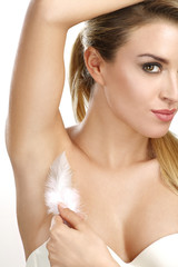 Wall Mural - beautiful woman showing her perfectly shaved armpit