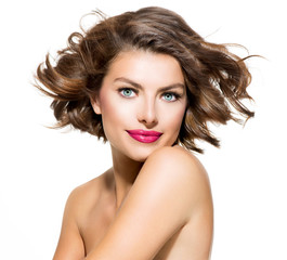 Wall Mural - Beauty Young Woman Portrait Isolated over White Background
