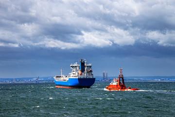 Ship at sea against a dramatic sky