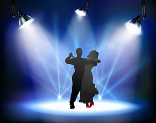 Dancing ballroom dance man and woman on the stage