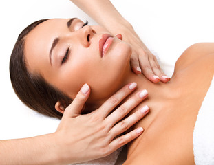 Wall Mural - Face Massage. Close-up of a Young Woman Getting Spa Treatment.