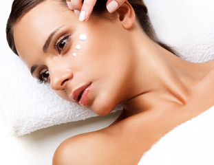 Wall Mural - Close-up of a Young Woman Getting Spa Treatment. Cosmetic Cream