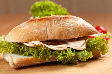 Tasty sandwiches with vegetables on a wooden table.
