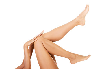 Attractive naked female's leg up.