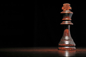Dark wood king chess piece
