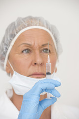 Hospital nurse with injection vaccination