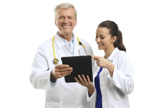 Close-up of senior doctor smiling on white background