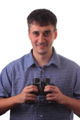 Man with binocular smiling