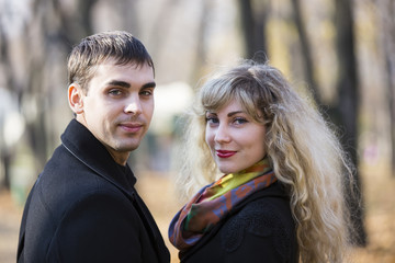 Portrait of a boy and a girl in the autumn park