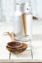 retro kitchen utensils tools on old wooden table in rustic style