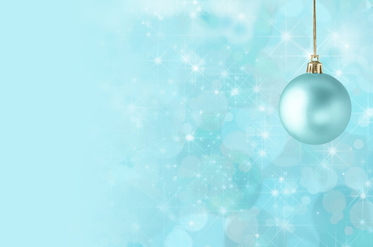 Christmas Bauble on Starry Bokeh Background