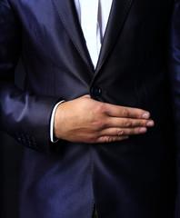 Close up  of stylish man in elegant black suit