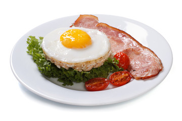 fried eggs with bacon, lettuce and tomato isolated on white