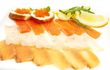 slicing fish and sandwiches with caviar