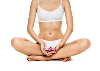 Young woman sitting in lotus position, over white background