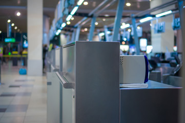 Empty check-in desks with computers in airport