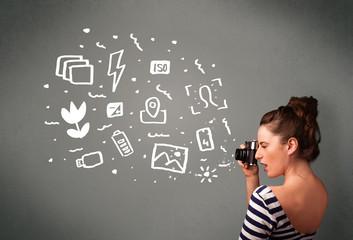 Photographer girl capturing white photography icons and symbols