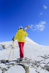 Ski, Freeride  - Woman with skis climbs to the top