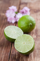 Limes on wood background