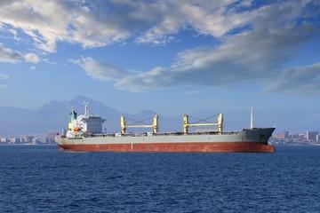 Big general cargo ship anchored in the bay of Alicante.