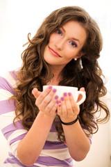 Beautiful girl drinking coffee