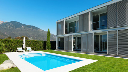 Modern villa with pool; view from the garden