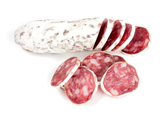 dried sliced salami isolated on white
