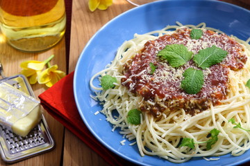 Spaghetti with cheese and mint leaf