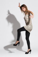 young beautiful woman playing with shadow. Studio photo