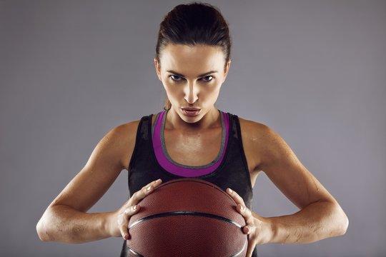 Portrait of female basketball player in studio