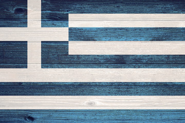 Greece Flag painted on old wood plank background.