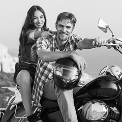 Fototapete - fashion couple sitting on a motorcycle